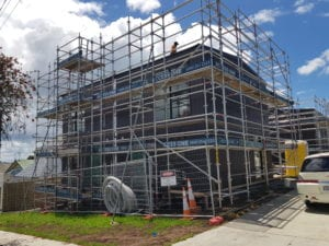 Residential work scaffolding with temporary fencing